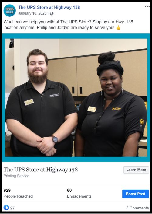 Two UPS employees smiling for the camera