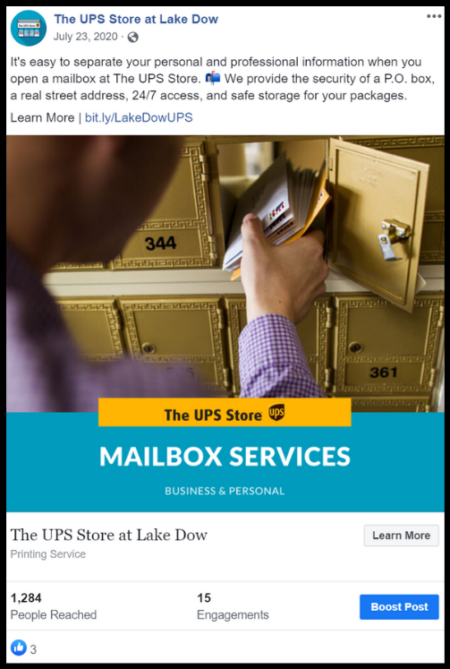 A customer putting mail into a UPS mailbox