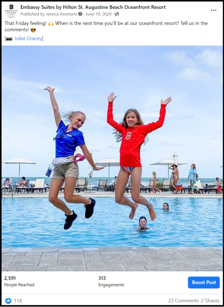 social media post showing two women jumping beside pool