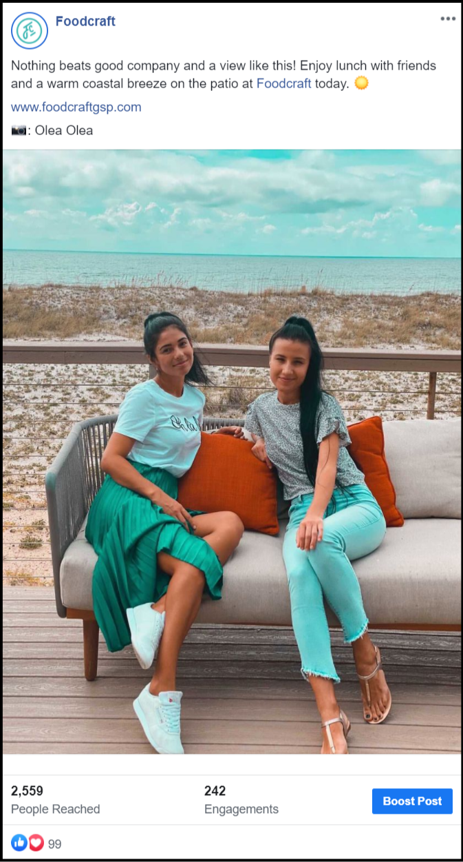 social media post showing two women at a beach front restaruant